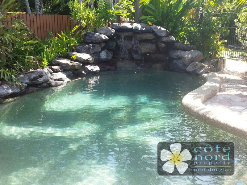 Lagoon style swimming pool with waterfall feature