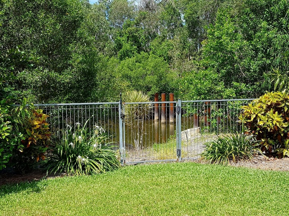Fenced. Tropical gardens and backing on to a creek