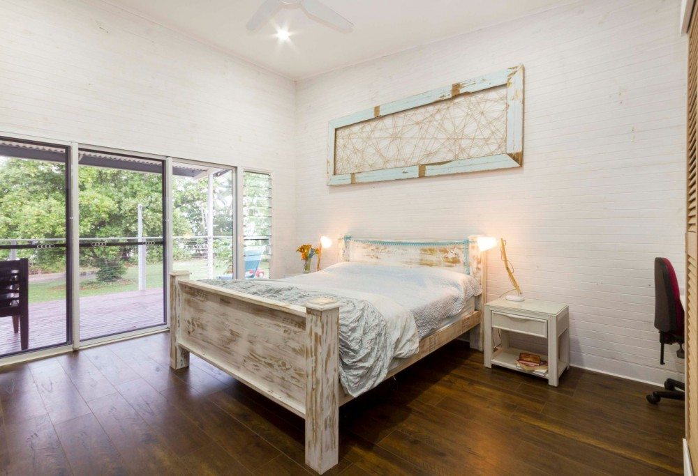 Main bedroom opening to the verandah and seabreeze