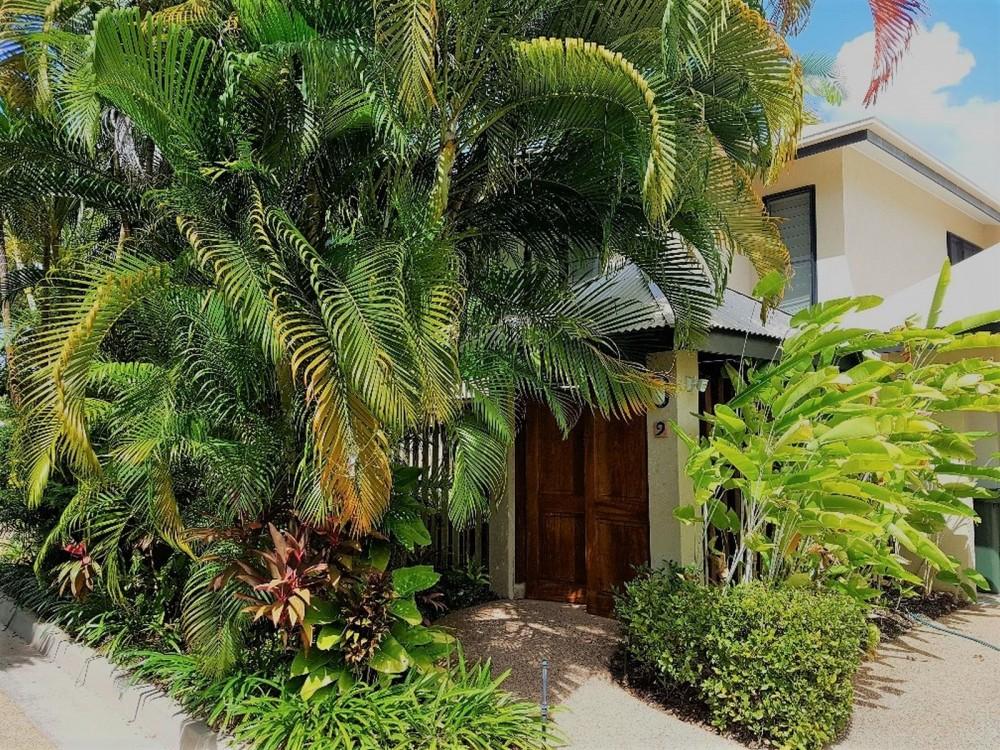 Lush tropical garden surrounds